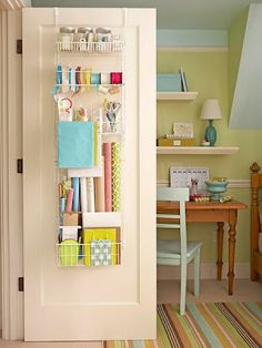 Organizing Gift Wrap on the back of a door - use a shelf and a wire to hold rolls upright, a hook for gift bags, a towel bar or shelf for spools of ribbon.