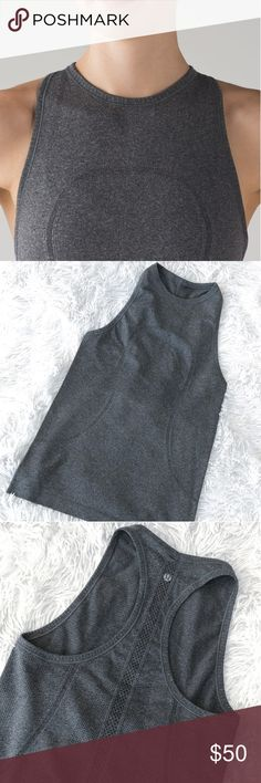 Lululemon Swiftly Tank Excellent like new condition. Worn once. Lululemon Swiftly crew neck racerback tank top. High neck. Heathered grey. Flattering fit. Size 4. Tag removed for comfort. I have too many of these exact tanks and I need to downsize my collection so it needs a new home :)   * I do not do trades * Price will be firm until sold * lululemon athletica Tops