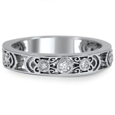 Love this!  Intricately Sculpted Wedding Ring from Brilliant Earth
