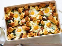 Italian Sausage and Egg Bake - edits: use 1/2 bag of browned hashbrowns on bottom, add artichokes, make holes shallow, don't leave goat cheese on for entire baking time.