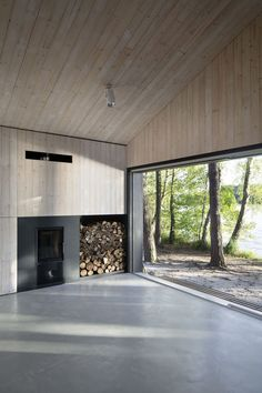 42 Lovely Scandinavian Fireplace To Rock This Year is part of - A stone fireplace design your pioneer ancestors would envy is the Multifunctional Fireplace The hearth is built up high to […] Scandinavian Fireplace, Scandinavian Cabin, Scandinavian Architecture, Interior Architecture, Sustainable Architecture, Ancient Architecture, Interior Design, Landscape Architecture, Stone Fireplace Designs