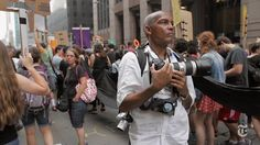 Here's a glimpse into a day in the life of a New York Times staff photographer. The behind-the-scenes video above follows 64-year-old photographer Ozier Mu