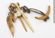 Anonymous, Central Arctic  Inuit: Inuinnaq?  1865-1930, 19th century or 20th century, Ivory, bone, hide, sinew  1.3 x 13.7 cm