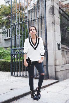 Blogger Style | Sara Escudero (Collage Vintage): varsity v-neck sweater x black ripped skinny jeans x balenciaga buckle boots