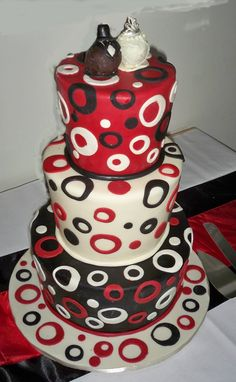 red black and with topsy turvey wedding cake
