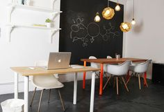 Love the lights with the chalkboard wall.  Very science-y.