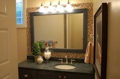 backsplash of tiles around mirror