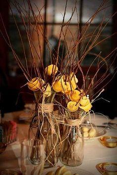 Milk jars, sticks, flowers and jute, a simple but pretty centerpiece