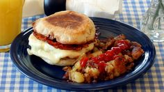 Murray's Breakfast Melt Recipe - New York City cheese shop Murray's has its own version of bacon, egg and cheese: melted Fontina cheese, cherrywood bacon and a fried egg, served on an English muffin that toasts right in the skillet or on the griddle.  #recipe