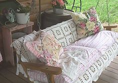 nothing like a porch swing....especially when adorned with lace