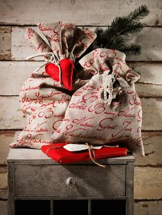 burlap bags - love the red writing