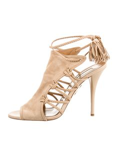Nude Aquazzura suede sandals with braided leather straps, suede tassel trim, tonal stitching and covered heels.  Includes shoe box and dust bag.  As seen on Kim Kardashian-West