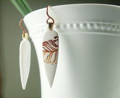 Polymer Clay White Earrings featuring Rust by WiredOrchidJewelry, $22.00