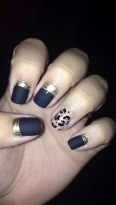 Reverse half moon and matte nails, with cheetah accent nail.   Products used.... -sechevite base coat -opi black -opi Samoa sand -Sally Hansen golden 1 -Nicole by opi matte top coat