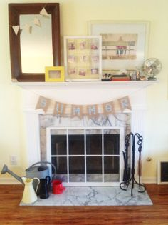 Love this summer themed mantle. All I have is the framed mirror, and watering can. I need to start developing some pictures!