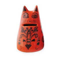 Lush Designs orange red cat shaped money jar with coin slot for mouth. Glazed eathenware with black printed details.