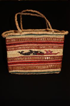 "Traditional Nuu-chah-nulth weaved carrying basket made by Gertrude Frank. Unlined Cedar Bark and Grass basket. Whale and Canoe design. 7 deep x 7.75 High s 11"" wide. $600  Northwest coast art and First Nations Art at Ahtsik Native Art Gallery."