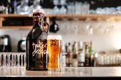 Local Père Jakob beer on tap and a special dark brew in that elegant bottle, what more could you ask for? Wine Bars, Geneva, Whiskey Bottle, Brewing, Mugs, Elegant, Tableware, Food, Bottle