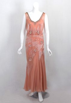 Hollywood-style beaded evening dress, 1930s, the soft pink hue is the perfect setting for the outer layer finely embellished with opaque white beads, clear crystal beads, and glittering rhinestones.
