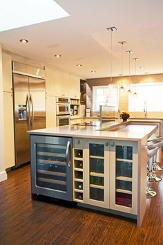 Wine storage, cook top on island without hood, step down seating, big windows in front of sink.