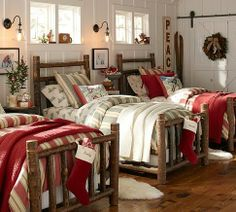 Great bunk room, with rough hewn log beds courtesy of Pottery Barn.  Love the sliding barn door closet, complete with wrought iron hardware.