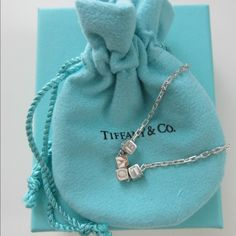 "Tiffany & Co. Era ""LOVE"" Cube Sterling Necklace Pendant is on an 18"" Sterling Silver chain Chain is a sparkling faceted chain Each bead is about 5 mm wide Each bead is hallmarked on the side ""(C)T&Co. AG925 Italy"" Chain is hallmarked near the clasp ""(C)Tiffany&Co. AG925 Italy"" In excellent brand new /unworn condition Comes with original pouch and box Tiffany & Co. Jewelry Necklaces"