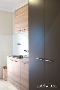 Polytec laundry - Doors in Maison Oak Ravine, Melamine doors and Laminate benchtop in Leather Matt. Laundry Bathroom Combo, Laundry Cupboard, Laundry Doors, Laundry Cabinets, Laundry Storage, Garage Cupboards, Laminate Benchtop, Timber Benchtop, Melamine Cabinets