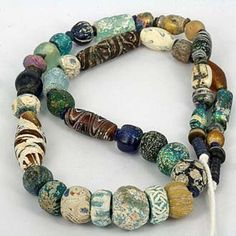 Ancient Glass Bead Strand with Heavy Patina
