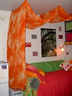 Command hooks, dowel rods, and a length of lightweight fabric make for a quick and easy bed canopy.