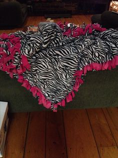 DIY three sheet fleece blanket light pink dark pink and zebra print easy just cut and tie sides 2 and a half yards gift for friend/sister made personalized with a crown patch. So cute and easy