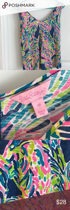 Lilly Pulitzer xs tank top shirt indigo palm read EUC Lilly Pulitzer tank top shirt in indigo palm reader xs. His has been worn a couple of times and always washed with a shout color catcher and hung dry. I also still have original tag just not attached. Lilly Pulitzer Tops Tank Tops