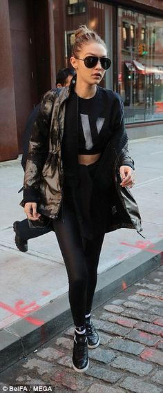 Close siblings: The Victoria's Secret models made sure to keep warm with Bella, 20, adding...