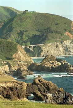 Heading south along the most beautiful coastline of US 100/Highway 1 approaching the historic Bixby Bridge by Big Sur, California  DJLaughlinArt