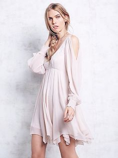 Tatiana Swing Dress | Sheer chiffon cold-shoulder babydoll mini dress with delicate embroidery and beadwork in a tonal palette. Features a scoop neckline and smocked cuffs. Dreamy and romantic, yet completely elegant, this gorgeous style features a hidden side-zip closure. Fully lined.