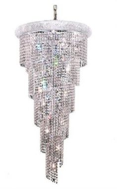 Adrienne - Hanging Fixture No Neck (18 Light Modern Grand Crystal Chandelier) - 1531SR22. This Adrienne - Hanging Fixture No Neck (18 Light Modern Grand Crystal Chandelier), is comprised of only the finest chandelier crystals and structure materials..  The beautiful lighting fixture, from our collection of magnificent crystal chandeliers, comes in a variety of finishes, crystal trims (including Heirloom Grandcut, Heirloom Handcut, Swarovski Elements & Swarovski Spectra) and crystal colors…