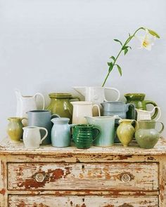 That prissy little yellowish-green vase standing on its tipi-toes in the front row!!