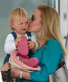 Autumn Phillips kisses Zara Phillips's daughter Mia Tindall as she attends day 1 of the Festival of British Eventing at Gatcombe Park on August 7, 2015 in Stroud, England.