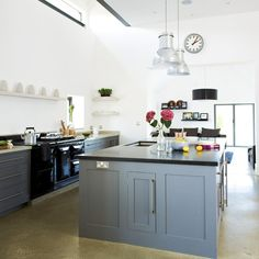 Modern country kitchen with grey island units Country kitchen units get a modern update in this kitchen with a lick of grey paint, while industrial-style light fittings over the island unit add interest. Kitchen Bryan Turner Read more at http://www.housetohome.co.uk/room-idea/picture/grey-kitchen-colour-scheme-ideas/5#zgc4T11zawsY6qw4.99