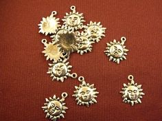 Sun Charms Tibetan Silver Lot of 12 by AGothShop on Etsy, $1.75