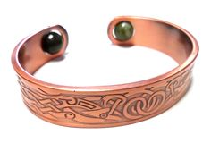 """Irish Connemara Marble """"Copper Spring Bangle"""" Bracelet. Genuine Connmara Marble from Ireland. Copper Spring Bracelet with Celtic Design. Handcrafted in Dublin, Ireland. Bracelet Width (approx.): 2.5"""" across and is adjustable. Gift Boxed & Brand New!."""