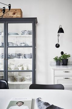 black dining room cabinet with glass doors / sfgirlbybay