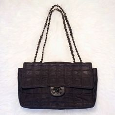 Chanel handbag  authentic 100% guaranteed authentic Chanel handbag. Black canvas exterior, leather & satin interior. Single or double chain strap. Turnlock closure. 1 exterior back pocket, 2 interior pockets (1 zipped, 1 open). Black printed logos on black canvas. Pre-owned condition, black chain & logo color peeling (showing silver). Purch. @ consignment store, was told strap was repaired (barely noticeable). Exterior & interior show signs of wear. Classic, timeless style! Approx…