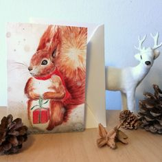 """Christmas Card: """"Squirrel with present"""". Xmas, holiday, cards, greeting, winter, nordic, traditional, woodland, hygge, squirrel, present by ArtLisbethThygesen on Etsy"""