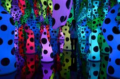 Dec. 12, 2013: A visitor is reflected in a mirror while visiting the 'Infinity Mirrored Room — Love Is Calling,' by Japanese artist Yayoi Kusama, in New York on Dec. 5. Two mirrored infinity rooms are currently on display at the David Zwirner Gallery.