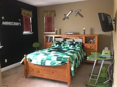 Bedspread is custom made by nic and marie, ore, picaxe, sword and torches by think geek, wood bed from potterybarn, and wall decal from etsy.