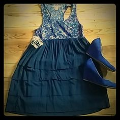 Charlotte Russe Comfy Racerback Tiered Dress Super soft and comfy! Navy blue with blue and purple floral print on top. Bottom is navy blue tiers. Bottom is lined so it is not see through. Charlotte Russe Dresses