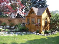 The Copper Creek garden shed located in Scarborough, Ontario features rough cedar channel siding and a pane arch window. The perfect backyard escape! Garden Sheds For Sale, Traditional Sheds, Storage Shed Kits, Fire Pit Area, She Sheds, Shed Design, Backyard Projects, Backyard Ideas, Backyard Gates
