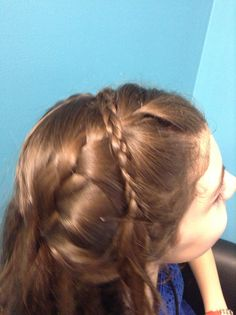 2 French braids and a headband braid. Part up, part down! Cute:)