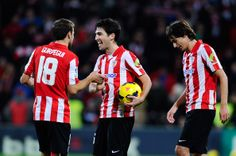 Andoni Iraola (C) celebrates with his teammates Carlos Gurpegi (L) and Ander iturraspe of Athletic Club after deafing FC Barcelona at the end of the La Liga match between Athletic Club and FC Barcelona at San Mames Stadium on December 1, 2013 in Bilbao.