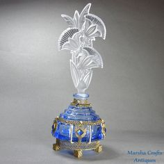 Blue Jeweled Czech Perfume Bottle with Floral Stopper from marshacraftsantiques on Ruby Lane